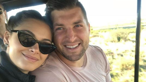 Tim Tebow taking a selfie with his girlfriend Demi-Leigh Nel-Peters