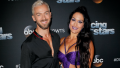 Nikki Bella posing with Artem Chigvintsev ahead of Dancing with the Stars