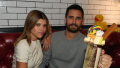 Sofia Richie and Scott Disick posing together with a milkshake at Sugar Factory
