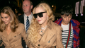 Madonna walking in Paris in a beige coat with black sunglasses