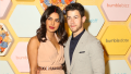 Priyanka Chopra posing next to husband Nick Jonas