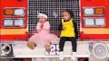 True Thompson and Dream Kardashian sitting on a firetruck