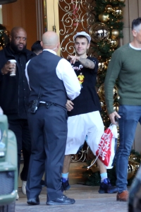 justin bieber all smiles at hotel with fans