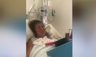 Abby Lee Miller in a hospital bed crying