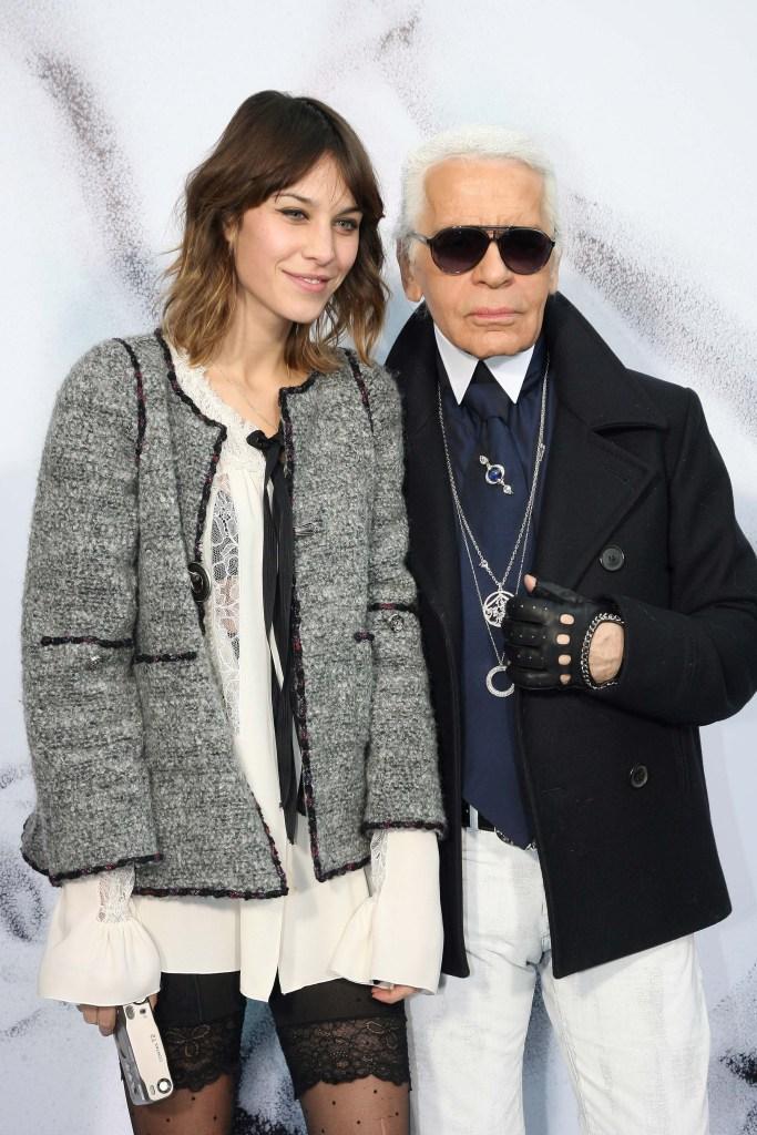 Karl Lagerfeld posing with Alexa Chung