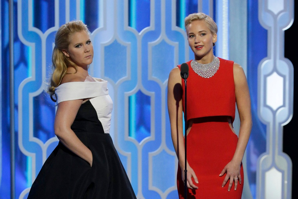 Presenters Amy Schumer and Jennifer Lawrence speak onstage during the 73rd Annual Golden Globe Awards at The Beverly Hilton Hotel on January 10, 2016