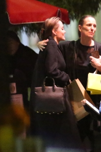 Angelina Jolie spotted out to dinner with friends wearing a black coat