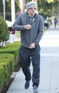 Ben Affleck in Los Angeles wearing a grey hoodie, grey sweatpants and Patriots beanie