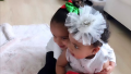 True Thompson and Dream Kardashian cuddling