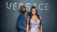 Kim Kardashian wearing a sparkly dress with Kanye West