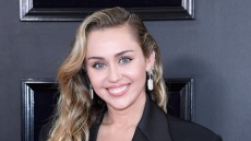 Miley Cyrus wearing a black pantsuit at the Grammys