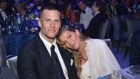 Gisele Bundchen leaning into husband Tom Brady