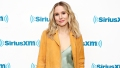 Kristen Bell wearing a yellow jacket