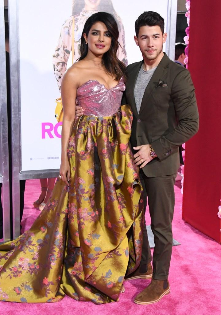 Nick Jonas Priyanka Chopra isn't it romantic premiere flowerd vivienne westwood gown