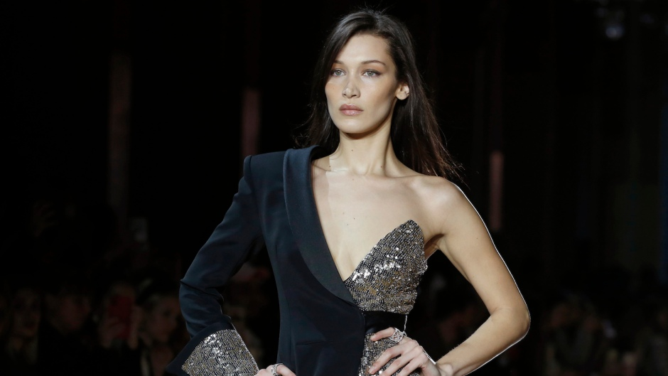 Bella Hadid says she has a 101 degree fever during paris fashion week