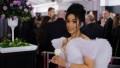 Cardi B wears a purple dress at the Grammy Awards