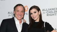 Dr. Terry Dubrow and Heather Dubrow wearing black