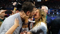 Gisele Bundchen kisses husband Tom Brady after patriots won super bowl LIII