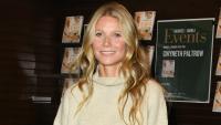 Gwyneth Paltrow smiling wearing a beige sweater