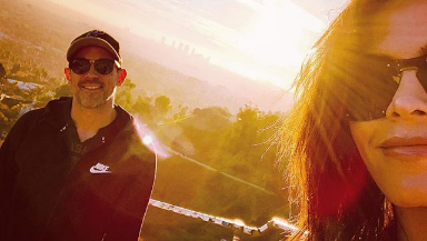 Jenna Dewan and Steve Kazee posing for a selfie in front of a sunset