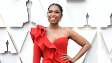 Jennifer Hudson in a red dress, smiling at the 2019 Academy Awards