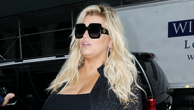 Jessica Simpson pregnant wearing a black dress and black sunglasses