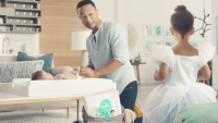 John Legend Changes Miles' Diaper In Super Bowl Commercial