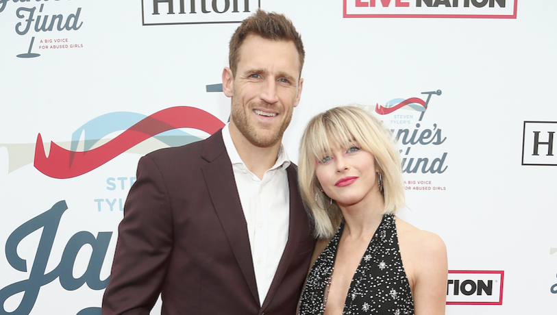 Julianne Hough posing with her husband Brooks Laich