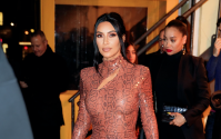 Kim Kardashian walking in NYC wearing a skintight, snakeskin dress
