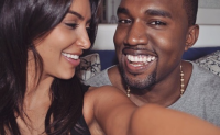 Kim Kardashian and Kanye West taking a selfie smiling