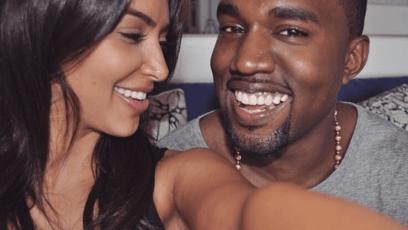 Kim Kardashian and Kanye West taking a selfie smiling