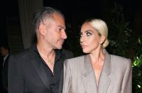 Lady Gaga and ex-fiance Christian Carino posing and looking at each other