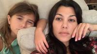 Penelope Disick and Kourtney Kardashian taking a selfie in pajamas