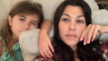 Penelope Disick and Kourtney Kardashian taking a selfie in pajamas