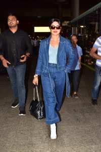 Priyanka Chopra wearing a 2 piece denim suit in the Mumbai airport