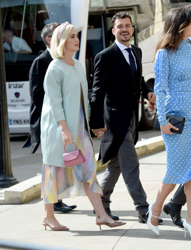 Katy Perry Wears Mint Green Coat and Pastel Dress With Orlando Bloom in Suit