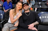 Model Behati Prinsloo and Adam Levine attend a basketball game between the Los Angeles Lakers and the Phoenix Suns at Staples Center on December 02, 2018 in Los Angeles, California.