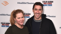Amy Schumer posing with husband Chris Fischer.