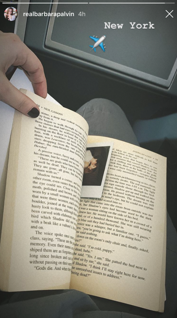 A picture of Neil Gaiman's American Gods with a Polaroid bookmark.