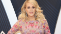 Carrie Underwood pregnant wearing a floral dress with her hair down