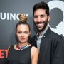 nev schulman and laura perlongo wearing black at an event