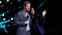 Meghan Markle and Prince Harry pack on PDA during appearance at we day event