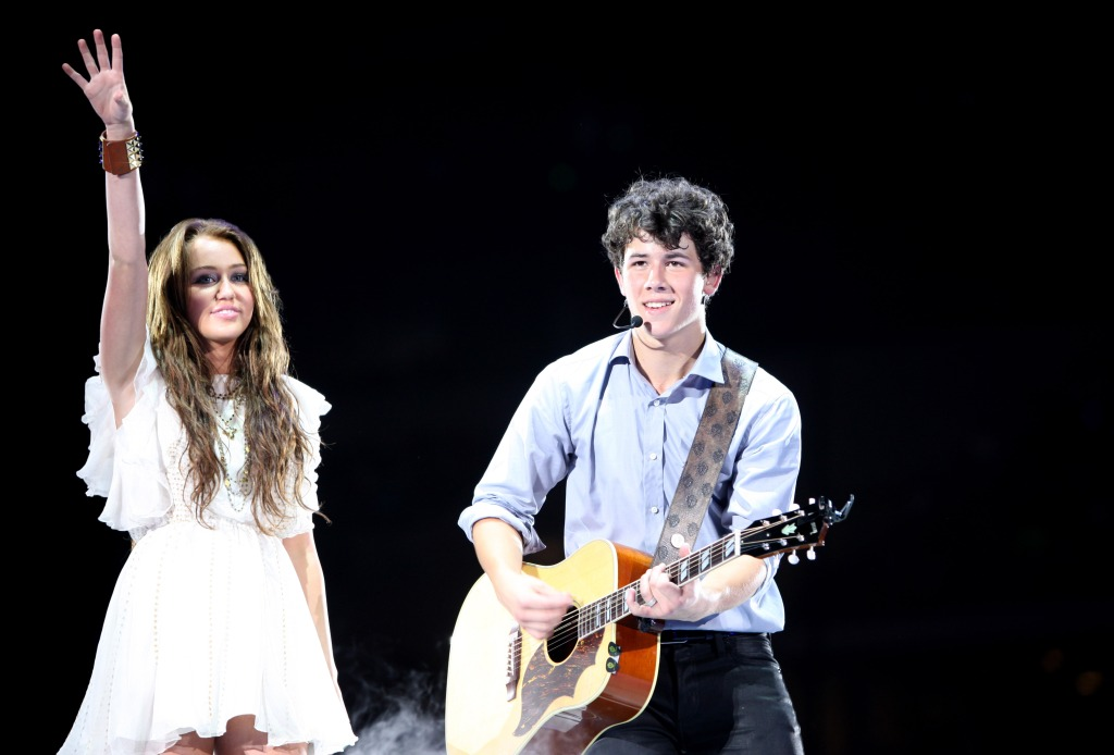 nick jonas and miley cyrus on stage