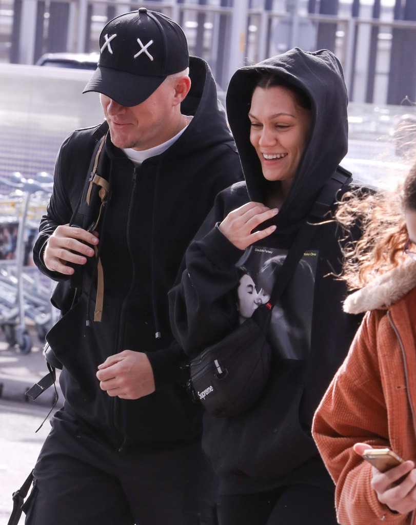 Jessie J and Channing Tatum holding hands through Heathrow airport.