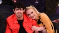 Joe Jonas and Fiancee Sophie Turner Share a Smooch While Courtside at Knicks Game