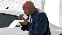 Kanye West eating lunch outside