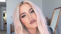 Khloe Kardashian selfie on Instagram with pink hair.