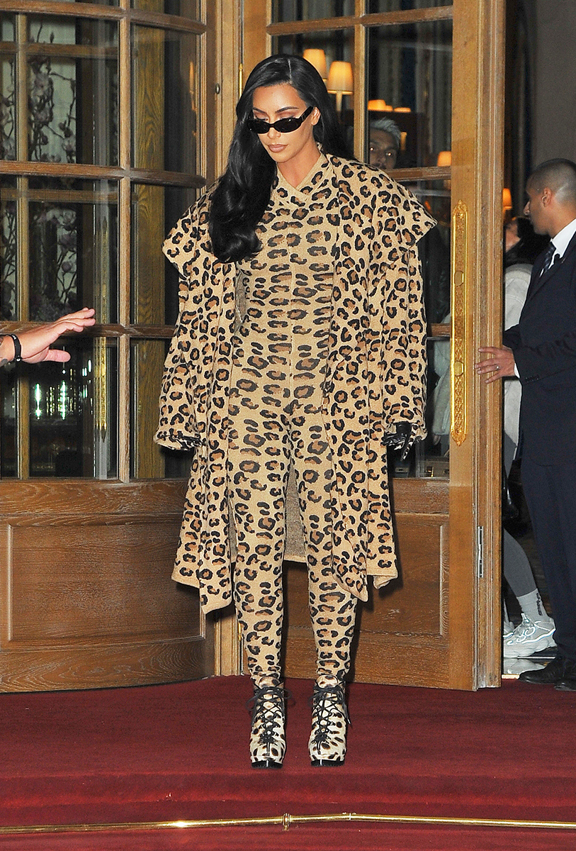 869f843aad25 Kim Kardashian Arrives in Paris Wearing Leopard Print Outfit