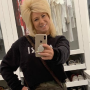 Theresa Caputo taking a mirror selfie on Instagram.