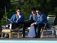 The Jonas Brothers reunite as a band to film a music video in Miami Beach